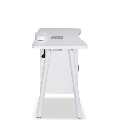 Manicure table equipped with a vacuum and dust collector.